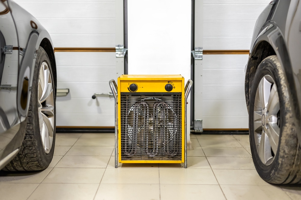 yellow heater next to two parked cars