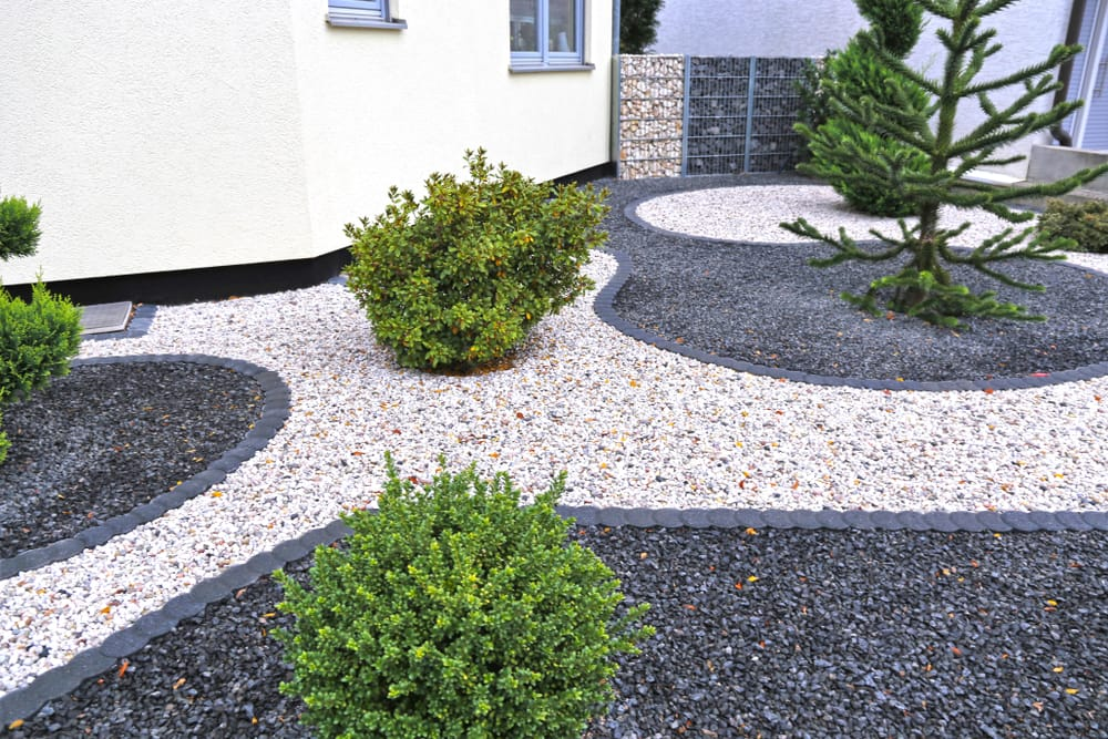 different colours of gravel with miniature shrubs