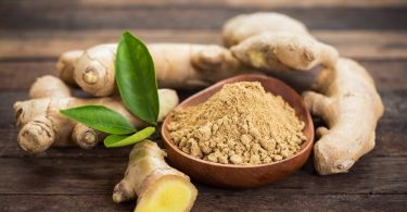 ginger root and powder in a bowl